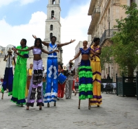 Colorful characters on stilts are just one attraction in Cuba.